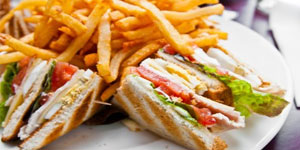 Sandwhich on plate with french fries